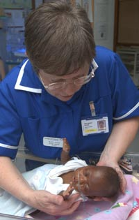 A nurse caring for a baby