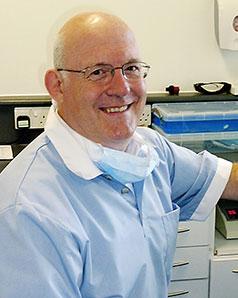 John Milne, Senior National Dental Advisor, in surgery