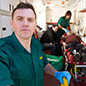 A paramedic standing in front of an ambulance