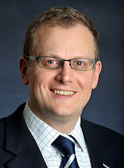 Portrait of Stuart Dean, Director of Corporate Providers and Market Oversight